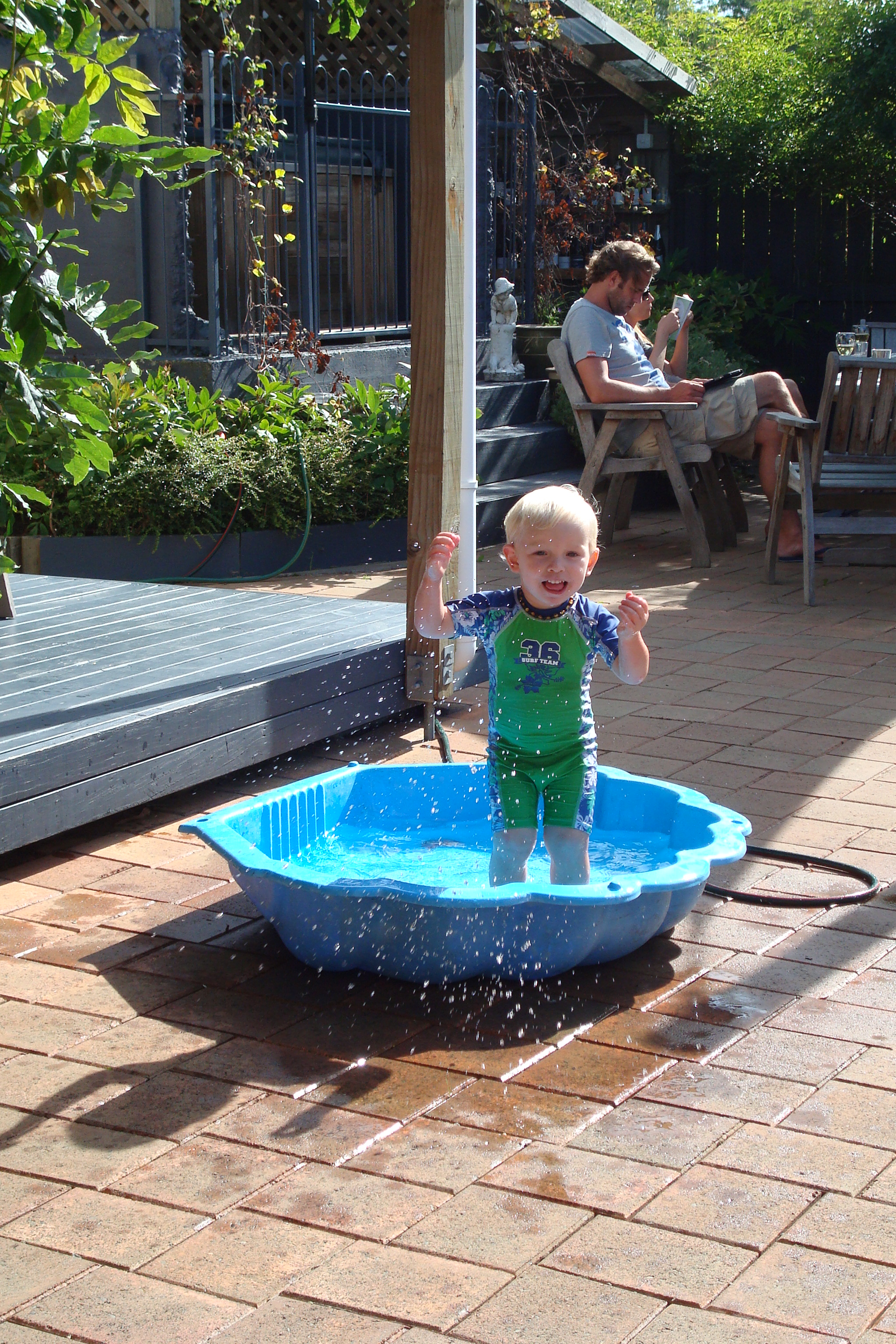 Toby playing in clam paddling pool